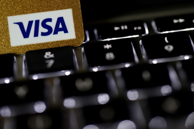 A Visa credit card is seen on a computer keyboard in this picture illustration taken September 6,