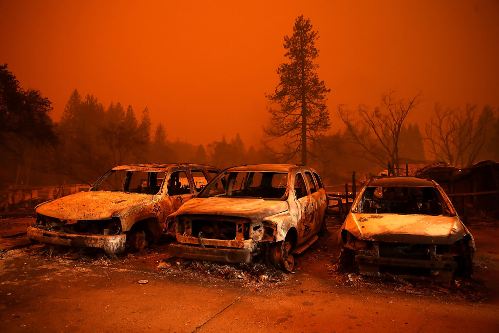 burnt vehicles in Camp fire in Paradise, northern California