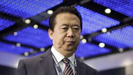 China Charges Former Interpol President With Bribery