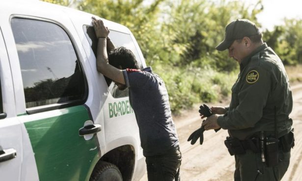 A Border Patrol agent prepares to search an illegal alien
