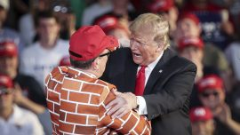 Trump Brings Man Wearing Wall Suit on Stage During Rally