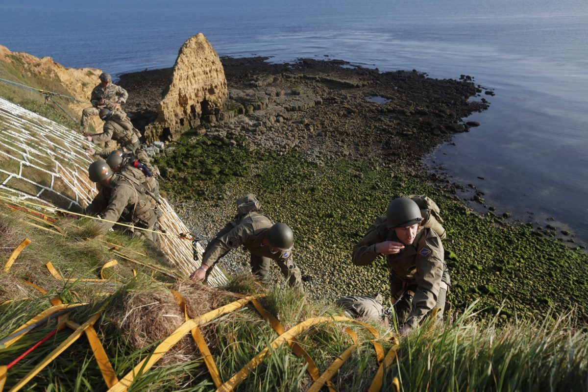 Soldiers climb the cliff of Pointe-du-Hoc