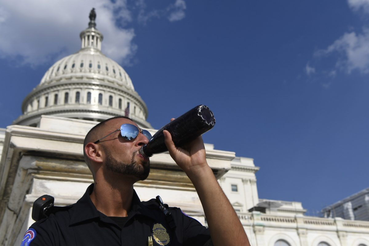 A Capitol Hill police officer takes a drink