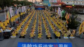 Candlelight Vigil at Chinese Consulate in New York Protests 20 Years of Persecution of Falun Gong