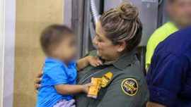 Photo: Border Patrol Agent Comforts Toddler Saved From Traffickers