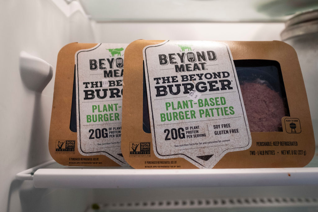 "Packages of Beyond Meat ""The Beyond Burger"" sit in a refrigerator, June 13, 2019 in the Brooklyn borough of New York City. Beyond Meat is a Los Angeles-based producer of plant-based meat substitutes, including vegan versions of burgers and sausages. (Photo Illustration by Drew Angerer/Getty Images)"