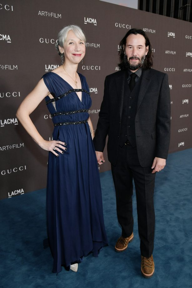 Alexandra Grant and Keanu Reeves holding hands