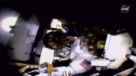 Astronaut Completes Spacewalk Without Helmet Camera, Lights