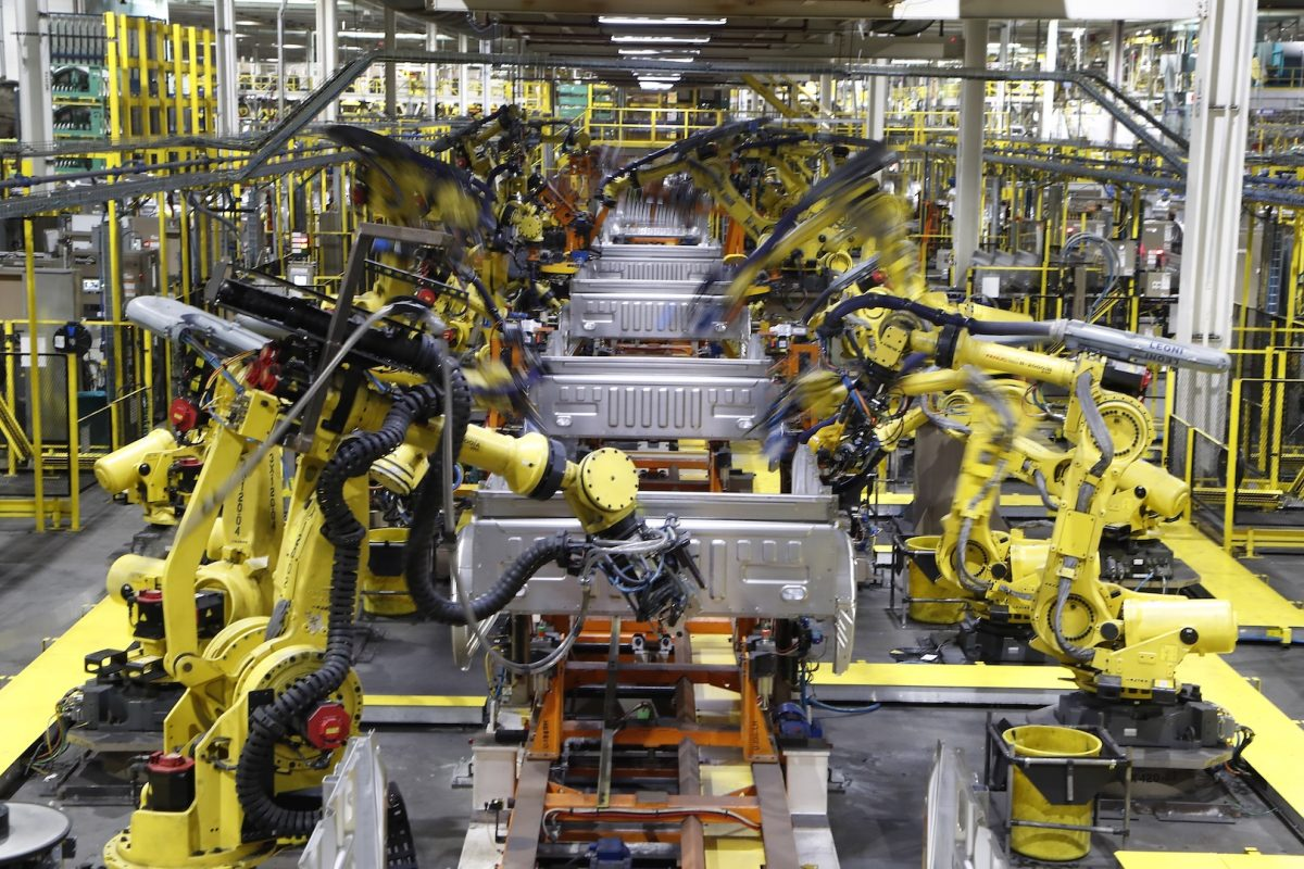 Robots weld the bed of a 2018 Ford F-150 truck on the assembly line