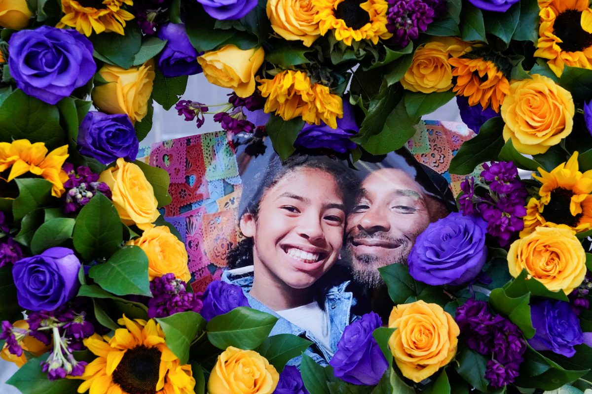 """Flowers and photos of Kobe Bryant and his daughter Gianna """"Gigi"""" are placed near the Staples Center"""