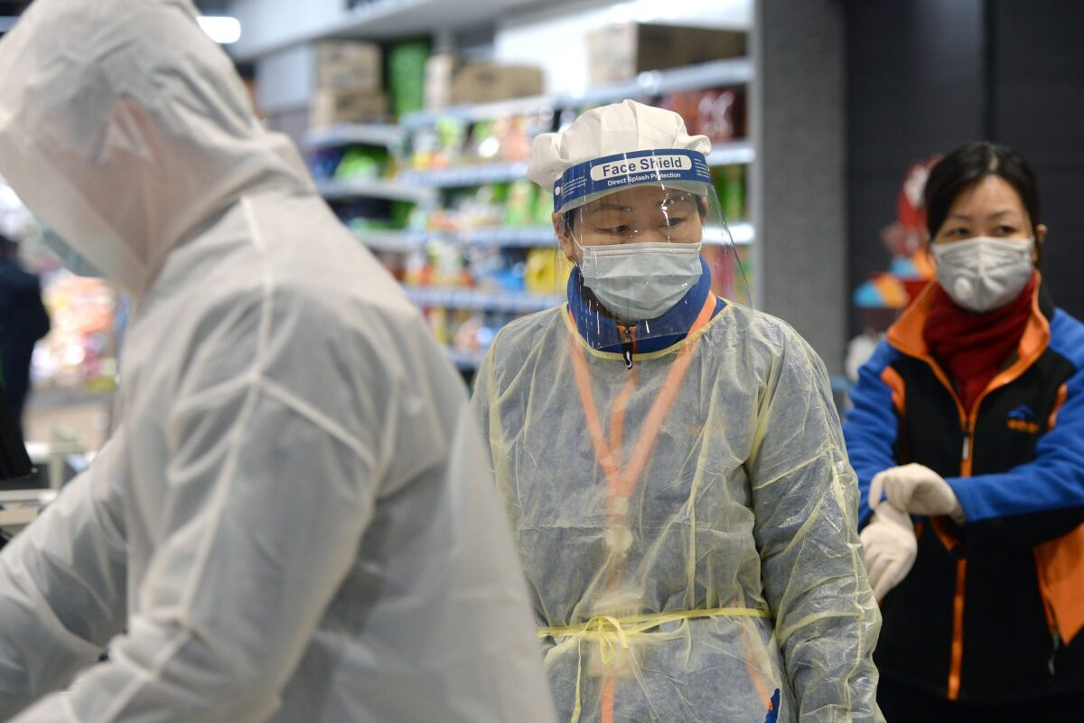 A staff member wearing a protective mask
