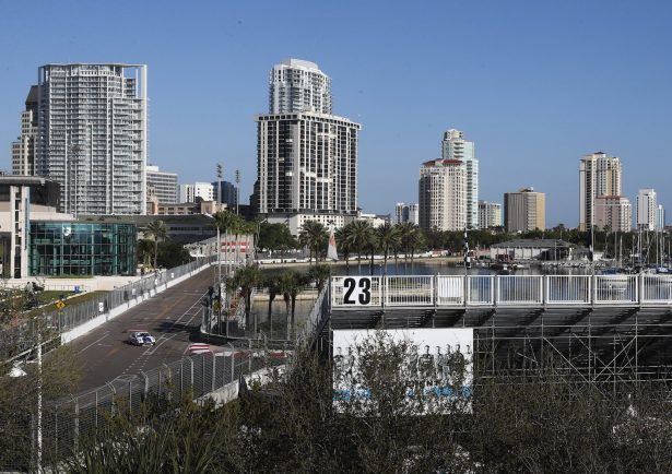 The grandstands are empty as cars makes their way around past the Mahaffey Theater and head towards turn 10 during the opening day of the Firestone Grand Prix of St. Petersburg