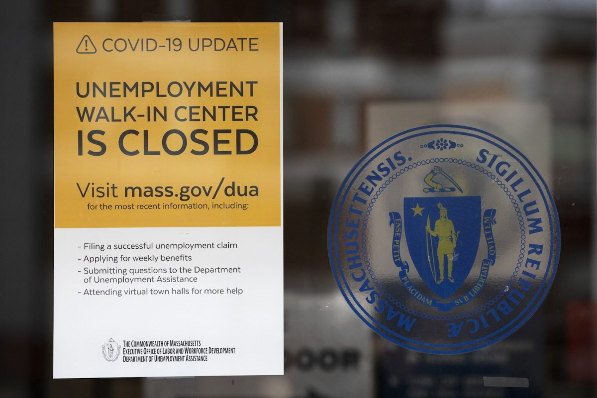 A sign announces the closure of the Massachusetts unemployment office