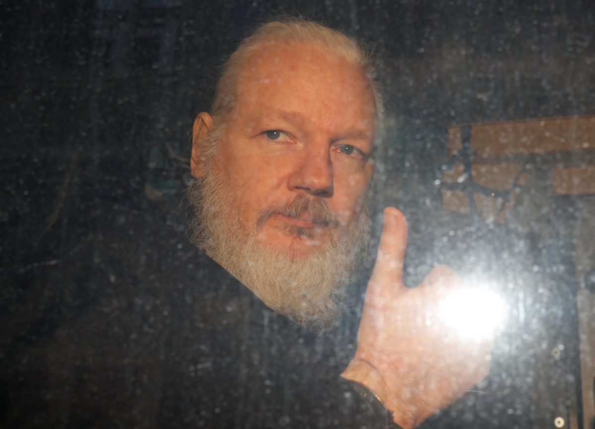 WikiLeaks founder Julian Assange is seen after was arrested by British police outside Westminster Magistrates Court in London