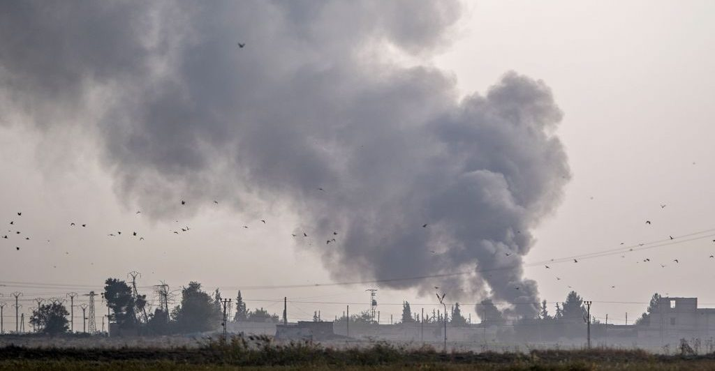 Smoke rises from the Syrian town