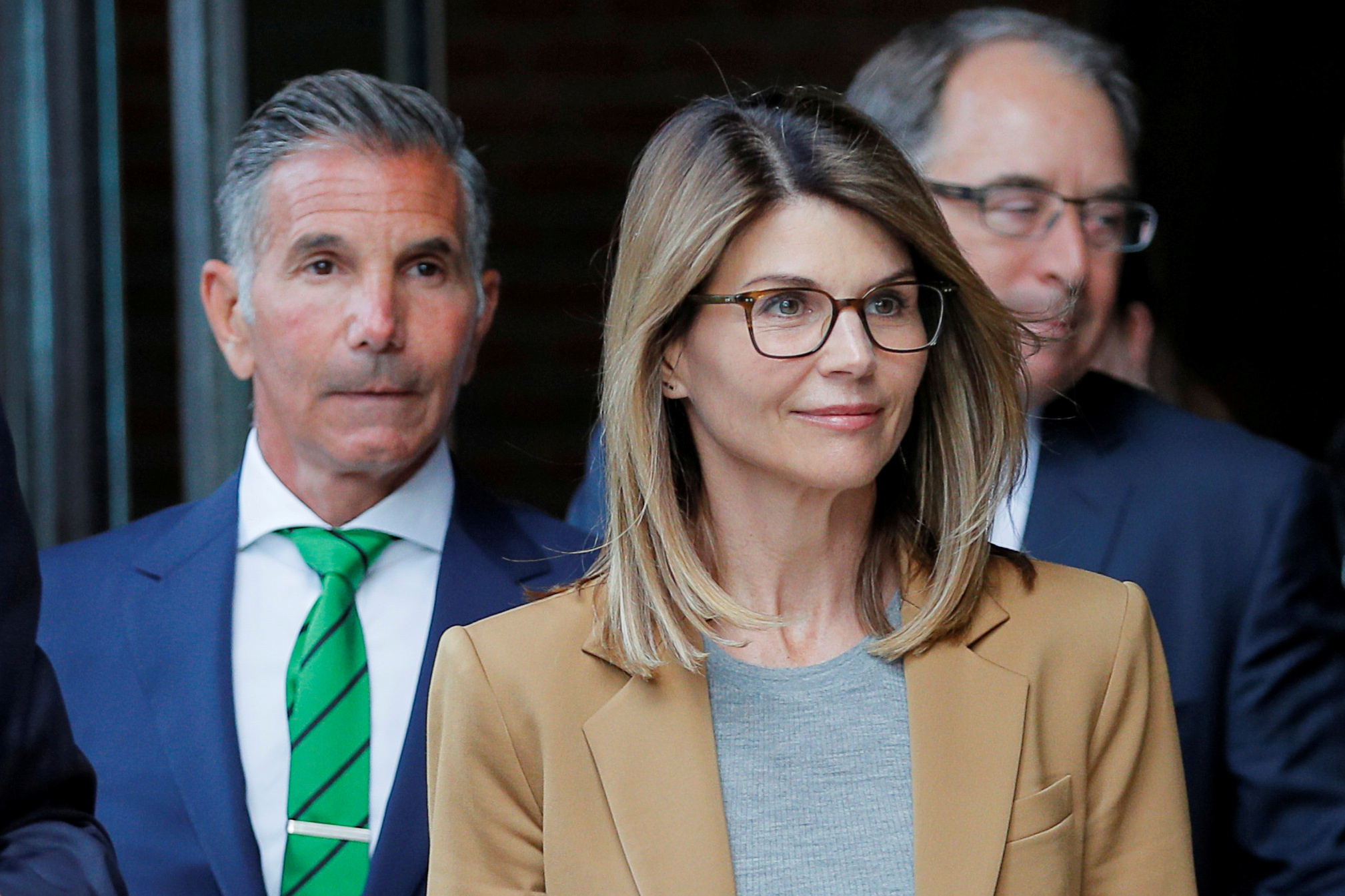 Actor Lori Loughlin, and her husband, fashion designer Mossimo Giannulli, leave the federal courthouse after facing charges in a nationwide college admissions cheating scheme, in Boston