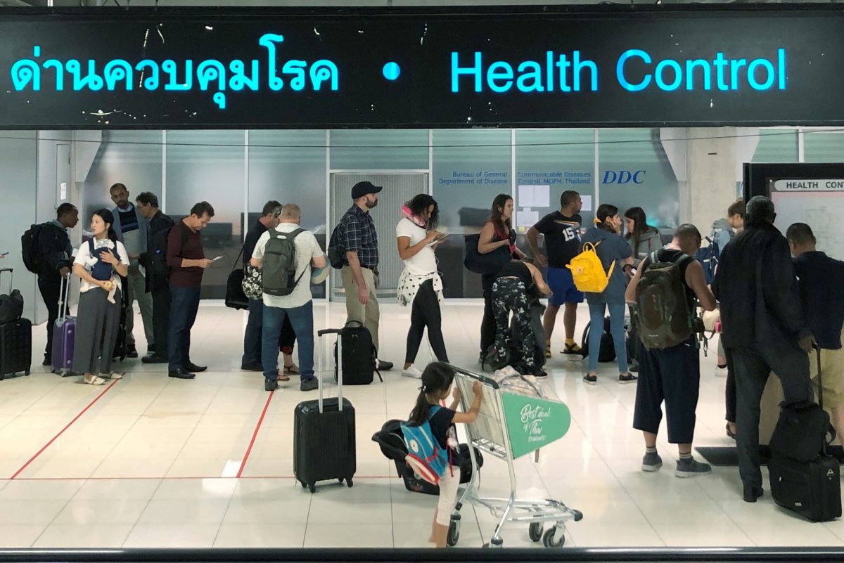 Tourist line-up in a health control at the arrival section at Suvarnabhumi international airport in Bangkok, Thailand