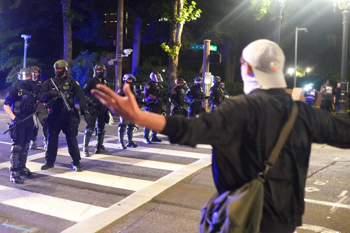 A protester taunts police